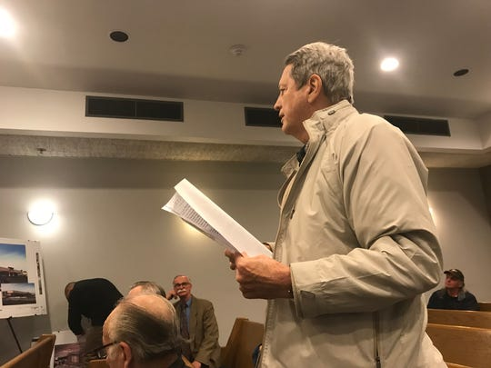Belleville resident David Yennior questions his local planning board on Thursday, March 29, 2018.