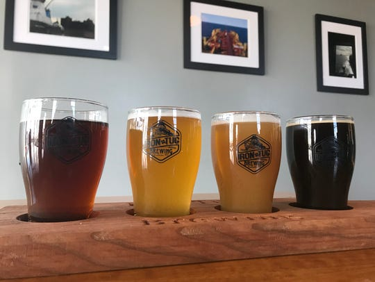 A colorful flight at West Ridge Road's Iron Tug Brewing.