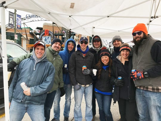 J.R. Blankenship, left, and his crew tailgate across from Comerica Park's entrance, starting at 7 a.m. Friday.
