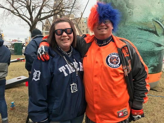 Katrina Martin, 28, and John Hill, 40, of Port Huron show off their Tiger apparel on Opening Day.