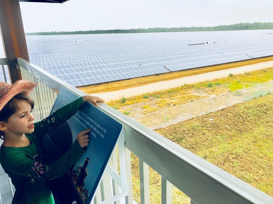 Quinn Hoban, 6, of Jupiter, Florida, looks over some information on the viewing platform at the Babcock Ranch Solar Energy Center.