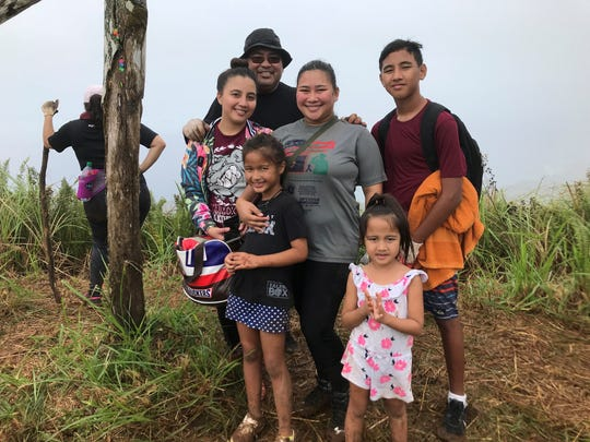 Families and friends participate in the annual Good Friday hike to the summit of Mount Jumullong Manglo, Friday, March 30, 2018.from left to right: Alexis Taitano, 20, Anthony Cruz, 49, Britney Quenga, 20, Dyllan Taitano, 15, Front: Alyssa Gumataotao, 9, Avery Taitano, 5