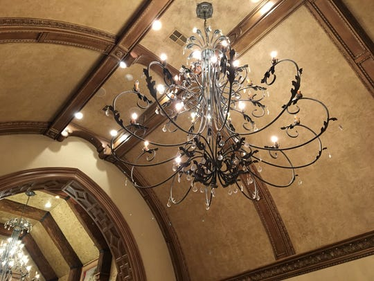 The chandeliers are 8 feet long and 8 1/2 feet wide.