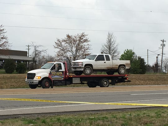 A truck, which law enforcement officials said was stolen by James Decoursey after allegedly killing a Hopkinsville police officer, is towed away from the parking lot of a Clarksville Cracker Barrel restaurant Friday, March 30, 2018.