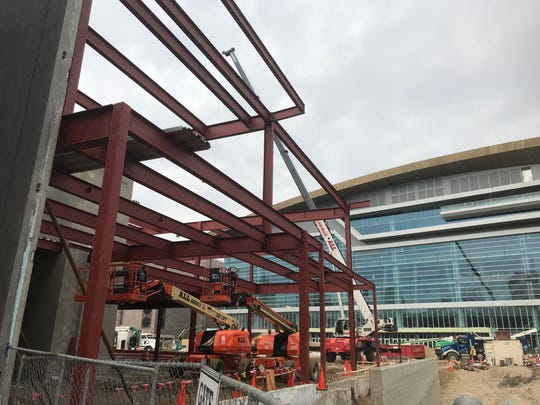 "Structural steel and walls have been erected for one of several buildings the Milwaukee Bucks plan for the ""entertainment block"" complex on the east side of the new arena."