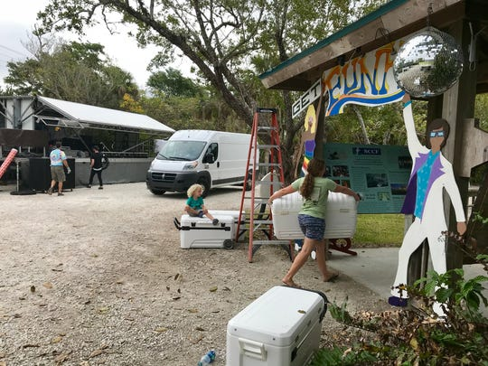 Organizers with the Sanibel-Captiva Conservation Foundation set up for Saturday night's Beer in the Bushes. Secret Service SUVs swung through the area Saturday morning.
