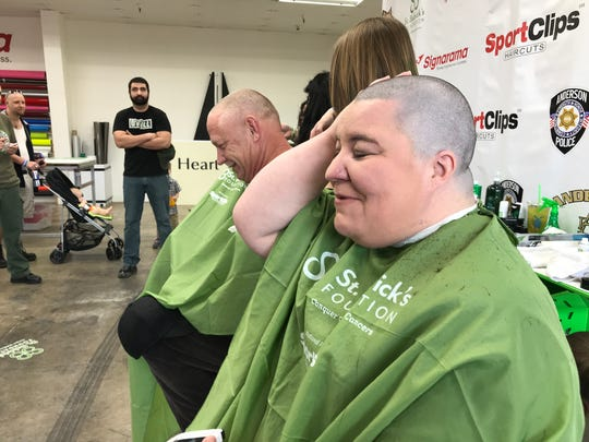 The first woman to step into a stylist's chair was Sarah Dumas of Cottonwood, who's been anticipating the St. Baldrick's event to get the cut and make a donation.