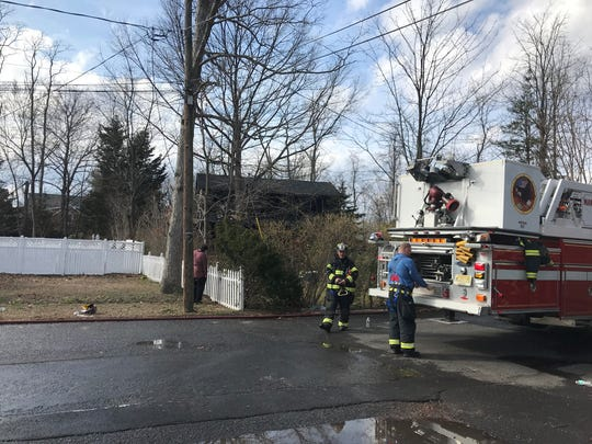 Firefighters fight a fire in Manasquan.