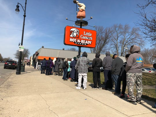 The line outside of Little Caesars on Grand River and
