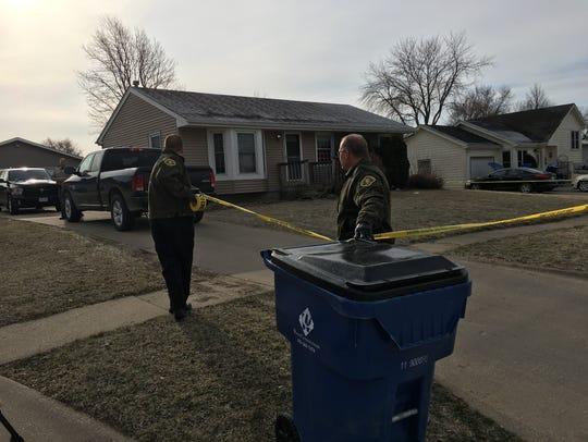 Warren County Sheriff's deputies secure the scene of