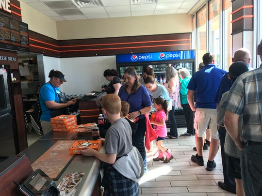 The line for free pizza started here at the Little Caesars restaurant on Cypress Avenue.