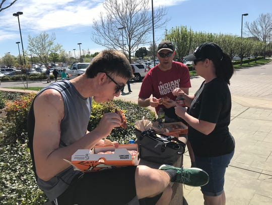 Indiana residents Mason, Stephanie and Vince Brooks, from left, enjoyed free pizza Monday while visiting family members in Redding.