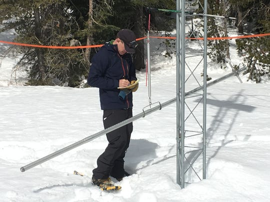 Hydrologist Jeff Anderson of the Natural Resources Conservation Service records the final snow survey of the 2017-18 winter on Slide Mountain near Reno.
