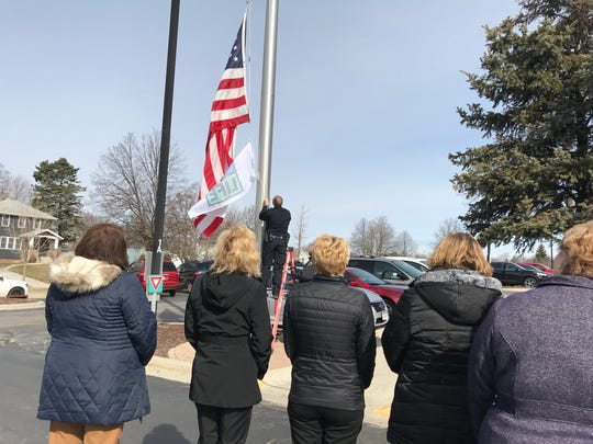 At 10:08 a.m. on Monday, a flag was raised to recognize that for every one donor, eight lives are saved.