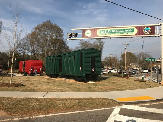Two boxcars that used to run on the Doodle Train are in place at the new Doodle Park in Easley.