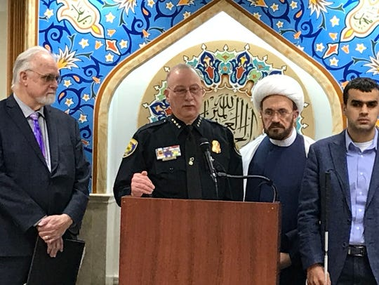 "Dearborn Police Chief Ron Haddad speaks at the Islamic House of Wisdom, a Dearborn Heights mosque, on April 3, 2018, condemning the ""Punish A Muslim Day"" flyers in the U.K. To his right is the Rev. Ed Rowe of Detroit and to Haddad's left is Imam Mohammad Elahi, the leader of the mosque."