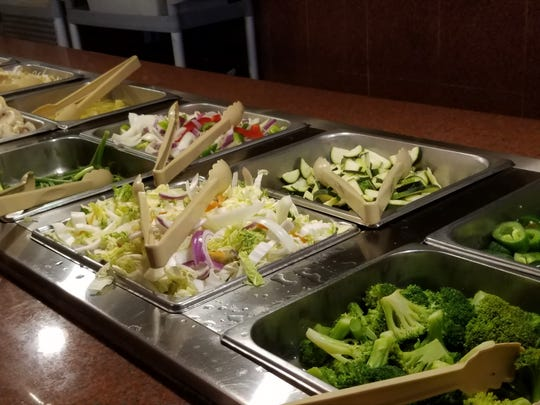 Take advantage of the Mongolian grill portion of larger buffets to design your own plate of veggies and lean meat. Pictured are vegetable offerings at Crazy Buffet.