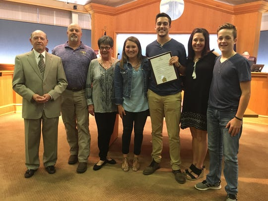 Garrett Jacobs (center) with family and Mayor Lorenz