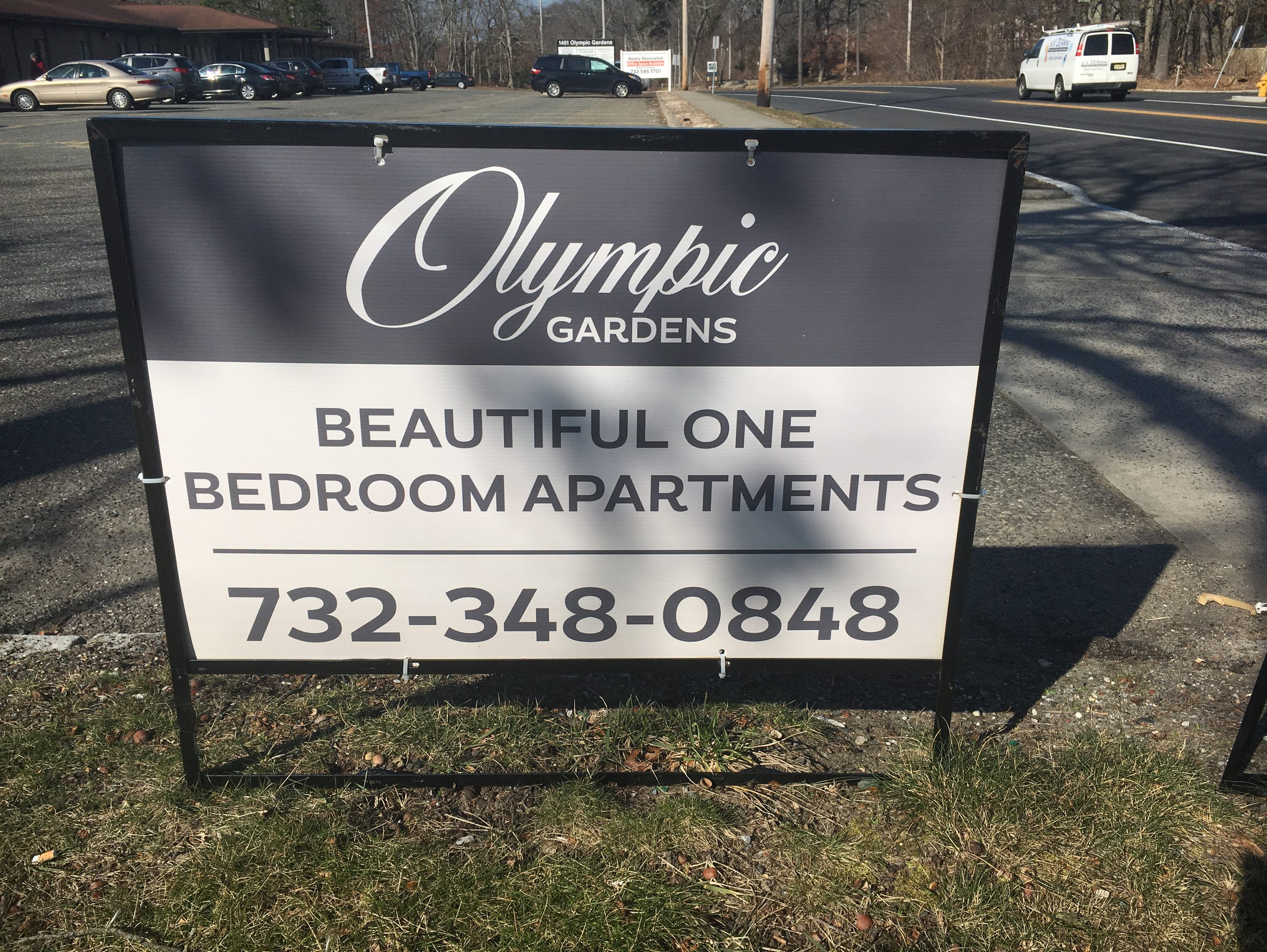 The sign outside Olympic Gardens, the 80-unit complex