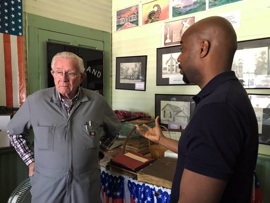 Evan Lewis (right) talks with John Waggoner (left) inside Colbert City Hall in April of 2017. Lewis asked if Waggoner knew any information related to his great-grandfathers lynching, which happened in Colbert in 1936.