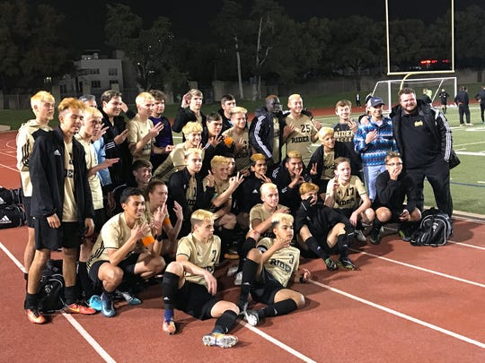 The Rider boys soccer team celebrates its 1-0 shootout