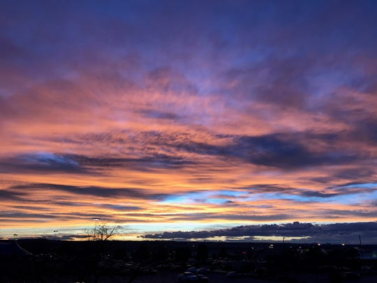 A sunset captured from the parking lot of Sunland Park