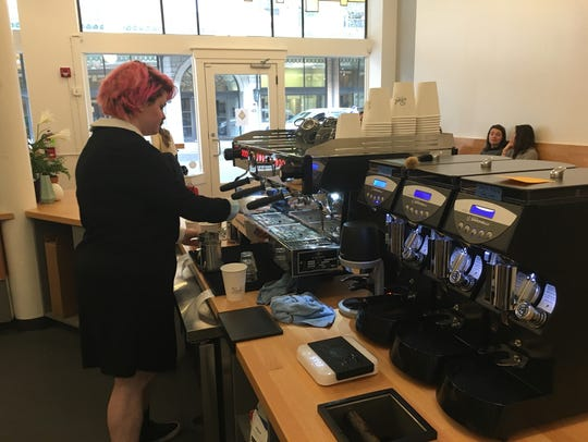 Caytie Wilkes preparing espresso at Pearl on Union