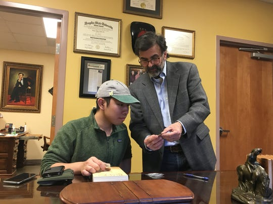 Wataru Yatabe, a student at Oswego State University in New York who hitchhiked to Huntsville, Tenn., to see where Howard Baker Jr. is buried, was befriended by General Sessions Court Judge James Cotton Jr. in Scott County. Cotton shared Baker memorabilia with Yatabe and gave him books written by Baker and himself.
