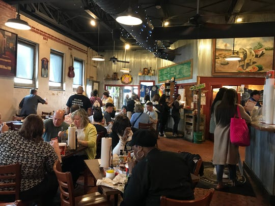 Business was bustling at Central  BBQ downtown Tuesday,