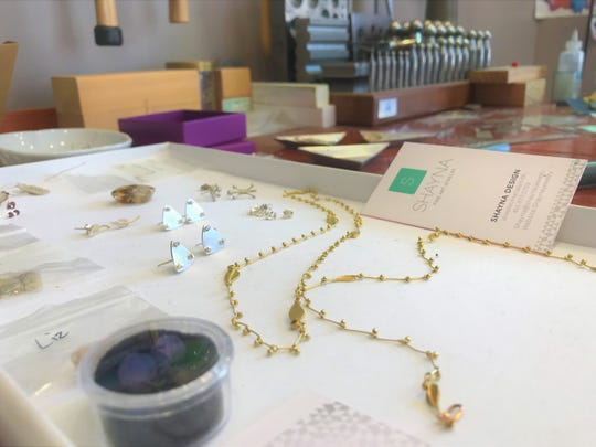 Shayna Jingst creates custom jewelry out of her studio at Jake's Cafe in downtown Sheboygan.