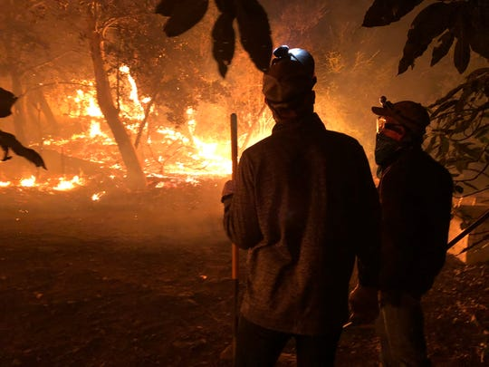 IndyCar driver Charlie Kimball, left, and his father, Gordon, helped fight a massive wildfire on the family's avocado ranch in Southern California in December. Nobody was injured at the ranch, though the family lost around 70 percent of its avocado trees.