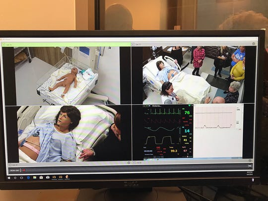 Computer monitors show visitors getting up close looks at  mannequins used by nursing students during a grand opening tour held at Angelo State University's Archer College of Health and Human Services building, Wednesday, April 4, 2018.