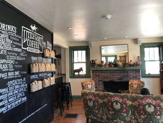 Customers can cozy up to the fireplace at the Little