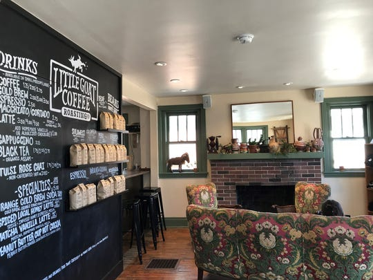 Customers can cozy up to the fireplace at the Little Goat coffeehouse in Newark.
