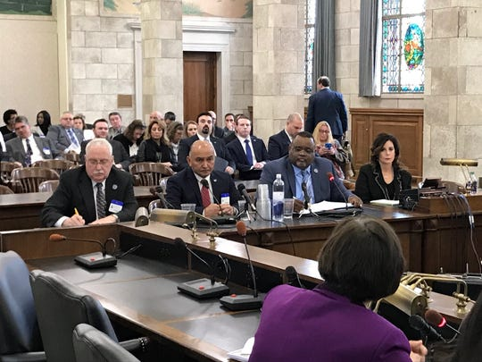 From left, Robert Bumpus, assistant commissioner in the Department of Education; Ben Castillo, director of the Office of School Preparedness and Emergency Planning; and Lamont Repollet, acting commissioner of the Department of Education, listen to questions from lawmakers at a hearing on school security in the Statehouse on April 5, 2018.