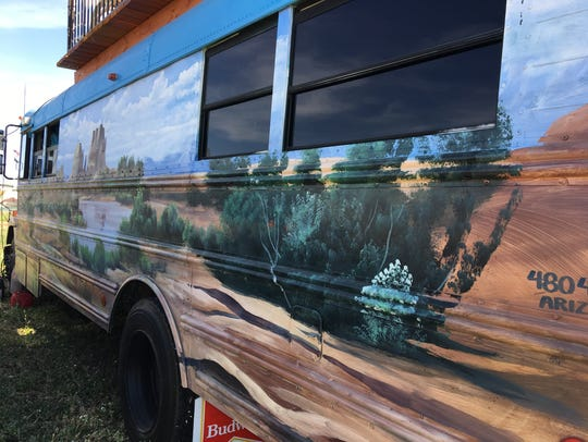 One side of the bus is painted with the Sedona landscape