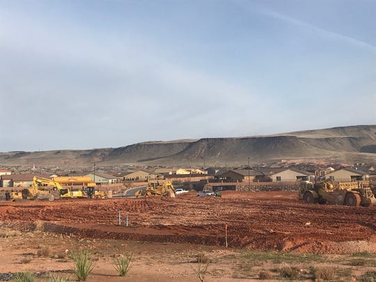 Heavy machinery clears the ground for more homes to