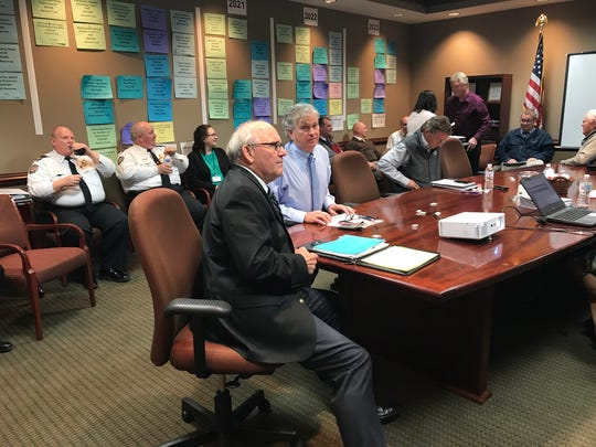 Collierville Mayor Stan Joyner and James Lewellen, town administrator scrutinize budget numbers before a work session of the board of mayor and aldermen.