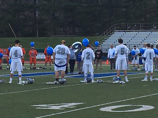 The Holmdel boys lacrosse team and the Middletown North