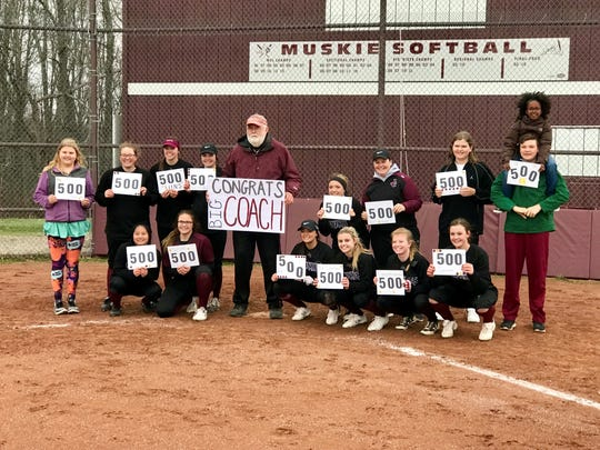 John Glenn coach Randy Larrick (middle) poses with his team after winning his 500th career game.