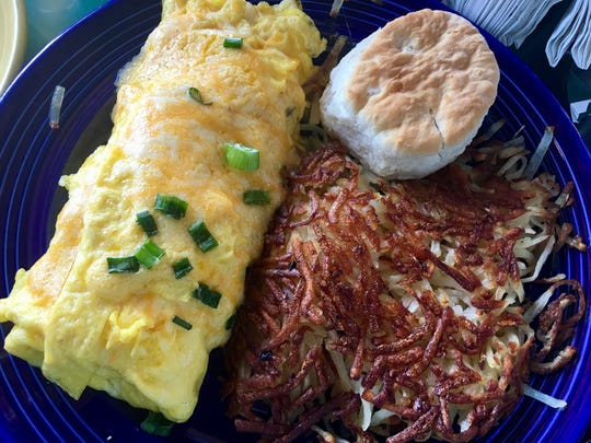 Daniel's Seafood Omelet   comes accompanied by hash