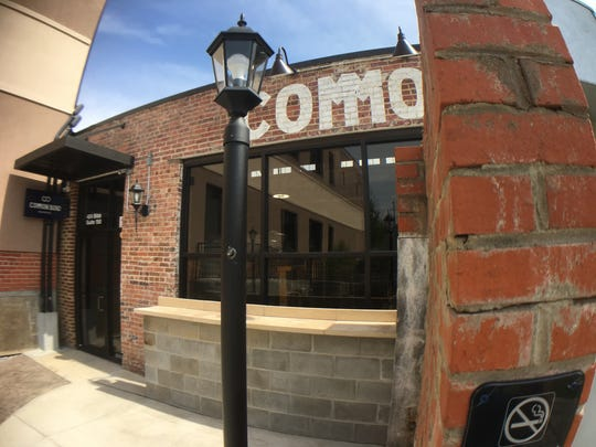 A speakeasy-style entrance leads into the taproom of Common Bond Brewers.