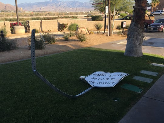A sign is visible on the lawn outside a Palm Springs Jack in the Box restaurant following a collision that cut off electricity to the business.