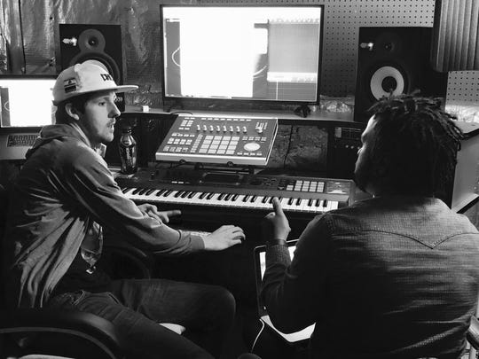 """Waynesboro's Andrew Hypes at his recording studio in Richmond with Bryce Collier working on the release of the """"Bartier Cardi"""" remix with Shaquille O'Neal."""