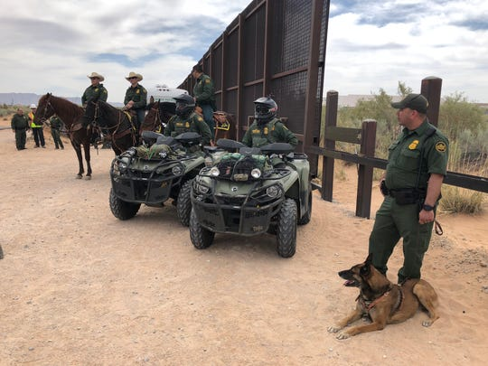 U.S. Border Patrol agents in the El Paso Sector in 2018 discuss the building of new border bollard fencing in Santa Teresa, New Mexico.