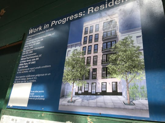 A work-in-progress sign at 163-165 E. 62nd St. in Manhattan. Developer Michael D'Alessio and his companies plan to build a six-story residential building.