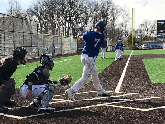 Millburn's Peter Serruto (7) attempts to knock in a
