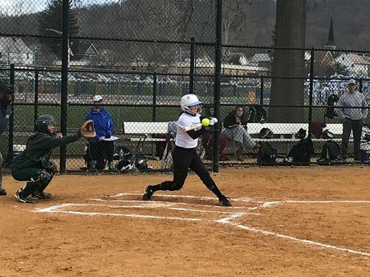 Millburn's Katy Shepard puts a bat on the ball against