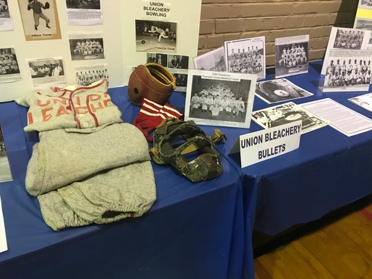 Historical artifacts of the Union Bleachery baseball team on display at Shoeless Joe Jackson Day.
