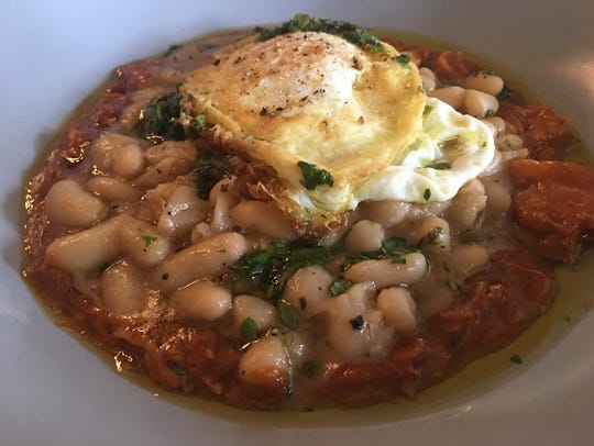 A fried egg over meaty cannellini beans is an excellent brunch choice at Catherine and Mary's.